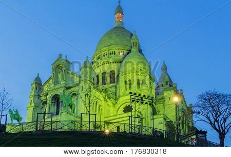 The Basilica Sacre Coeur lit with green light for celebrate St. Patrick's Day Paris France