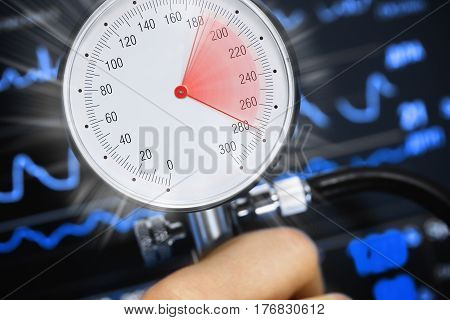High blood pressure on the tonometer against the background of the cardiac monitor. Abstract concept medical image