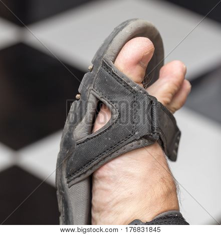 male foot in sandals . Photo taken by professional camera and lens