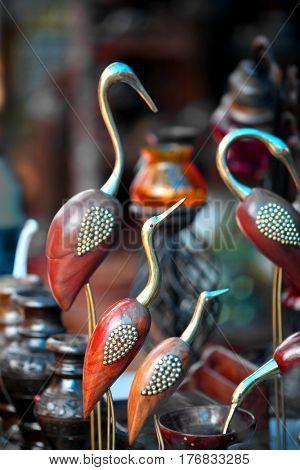 Metal cranes Indian handicrafts close up shot