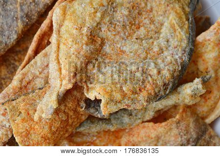 crispy fried fish skin with seasoning on dish