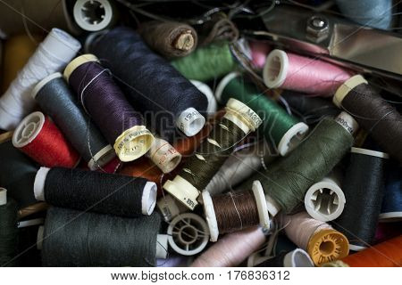 Pile Of Spools Of Thread Of Various Colors For Backgrounds