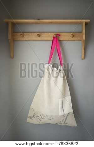 Cloth Drawstring Bag Hanging On Wall Rack
