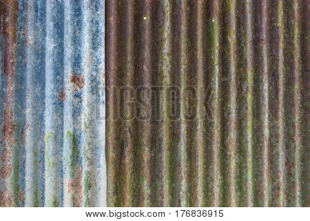 Rusty Corrugated Metal Sheet Background / Texture