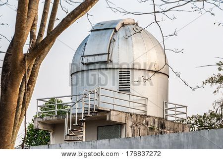 Gray Stained Observatory with Spiral Staircase in Cloudy Day