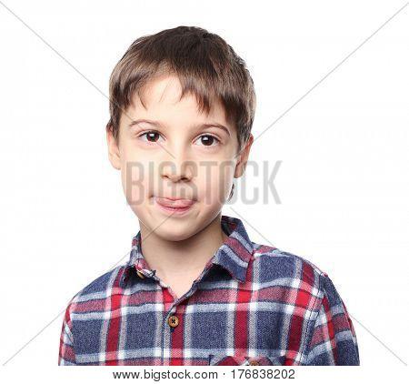 Portrait of cute little boy on white background