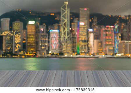 Hong Kong city downtown blurred bokeh light night view abstract background opening wooden floor view