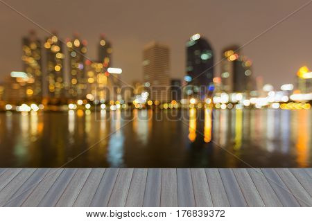 Night blurred bokeh office building with reflection opening wooden floor