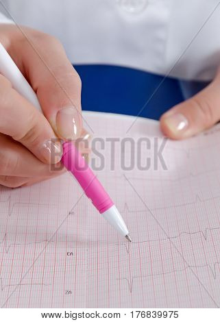 Electrocardiogram in the hands of doctor .