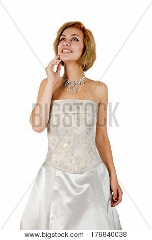Happy girl in a white strapless evening dress with bare shoulders and necklace isolated on a white background.