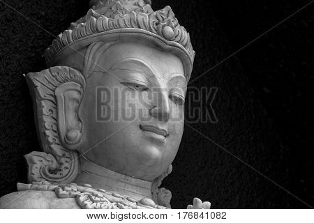 Traditional Asian stone carving of Buddhism deities illustrating Asian culture and Asian carving craft