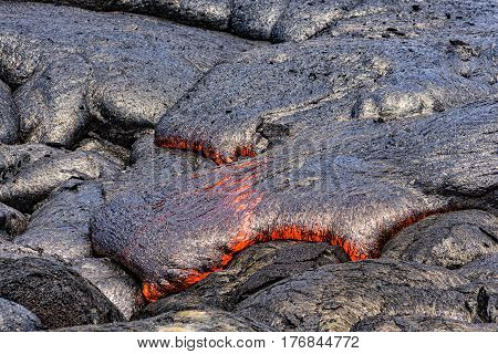 Lava flowing near Puuoo Crater Volcanoes National Park Big Island Hawaii