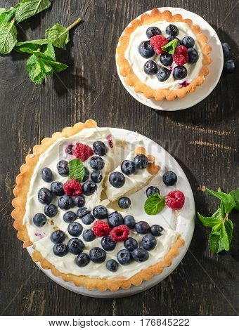Tarts With Berries And Whipped Cream.