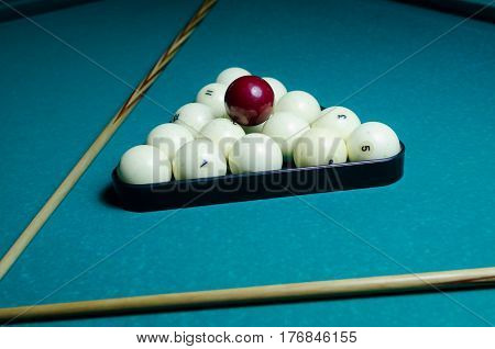 Russian billiards balls and cue on the table, the pyramid