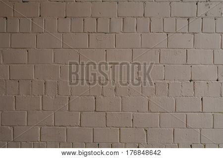 Old brick brick wall painted with brown paint for texture and background.