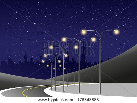 Winding Night Road Lit By Electrical Light Poles