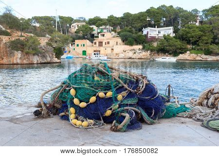 Fishnet In Fishing Village Cala Figuera And Mediterranean Sea, Majorca, Spain