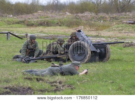 SAINT PETERSBURG, RUSSIA - MAY 05, 2015: German artillery with anti-tank gun into position. Reconstruction of the episode of the great Patriotic war