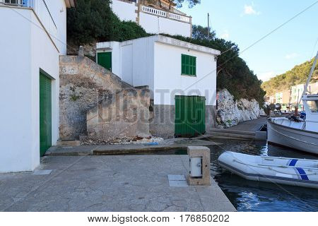 Fishing village Cala Figuera port with boathouses and green gates Majorca Spain