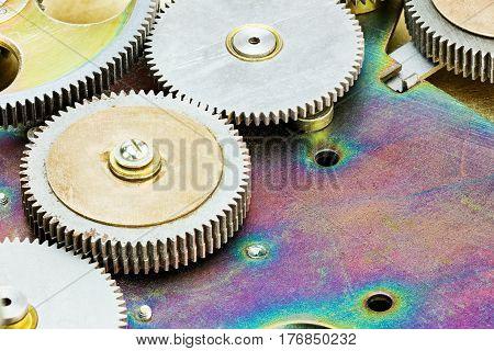 Various Cog Wheels Gears On Metal Background Closeup View