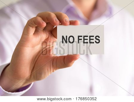 Businessman Holding A Card With No Fees Message
