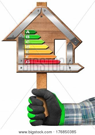 Hand with work glove holding a wooden sign in the shape of house with energy efficiency rating. Isolated on white background