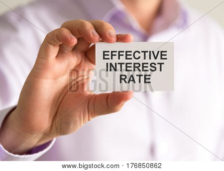 Businessman Holding A Card With Effective Interest Rate Message