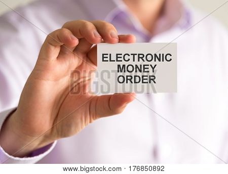Businessman Holding A Card With Electronic Money Order Message
