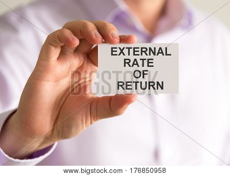 Businessman Holding A Card With External Rate Of Return Message