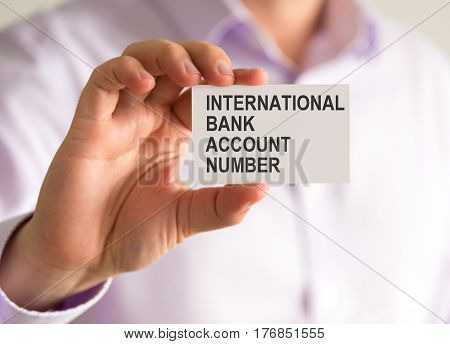Businessman Holding A Card With Iban International Bank Account Number Message