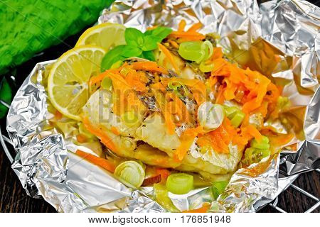 Pike With Carrots And Basil In Foil On Board