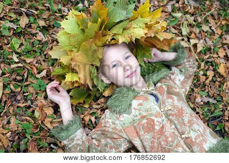 beautiful caucasian girl on fall yellow leaves cover background