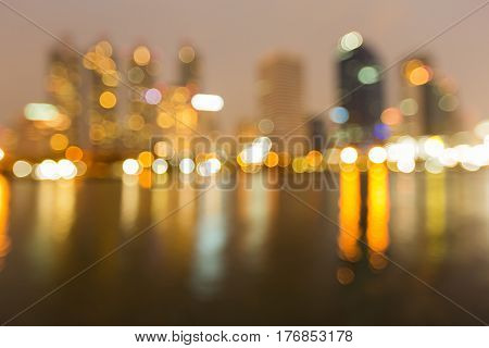Reflection blurred bokeh light city office building night view abstract background