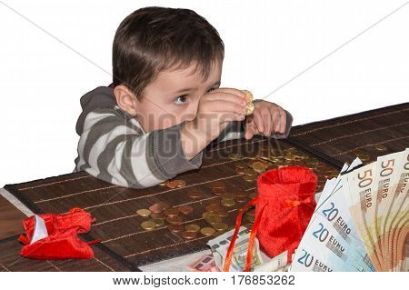 Child and a pile of money coins. Concept Save money.