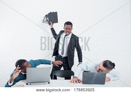 Firing from the company. Leaving the office. Furious ex-worker crashing his laptop. Stress at work, overworking, problem in the working team concept