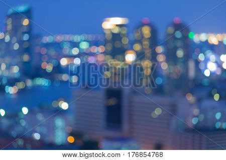 Twilight blurred city light business downtown abstract background