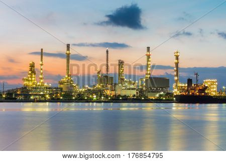 Oil refinery river front with sunrise sky background industrial landscape background