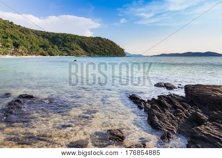 Natural rocky beach over seacoast and blue sky background natural seascape background