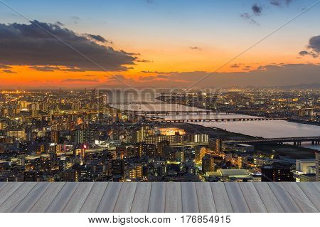 Opening wooden floor aerial view city of Osaka with sunset skyline citscape downtown background