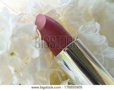 cosmetics and lilac blossom Lipstick on white Lilac flowers background