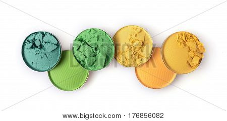 Round Yellow And Green Crashed Eyeshadow For Makeup As Sample Of Cosmetic Product
