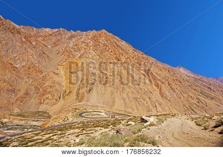 A Truck on a Winding Road in the High-Altitude Mountain Desert in the Himalayas, Ladakh, Northern India.