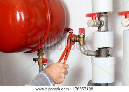 repair man is working in a heating room