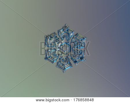 Macro photo of real snowflake: medium size snow crystal of star plate type (around 4 millimeters from tip to tip) with simple hexagonal shape, six short, broad arms and frozen bubbles of rime on glossy surface. Snowflake glitters on smooth gradient backgr