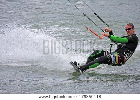 kitesurfer riding on the edge of his board