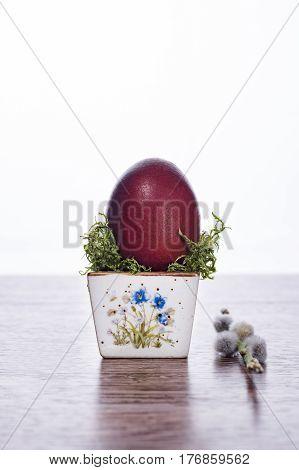 Single Ester egg in little bowl. Happy Easter.