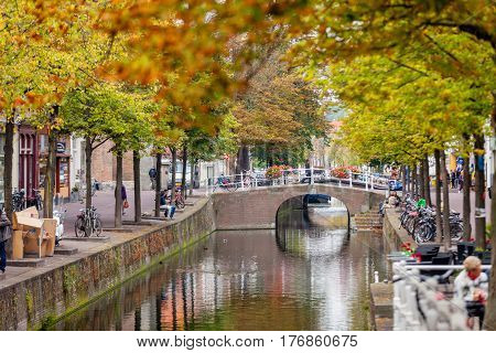 DELFT NETHERLANDS - September 23 2014: beautiful view on street full of bicycles and people