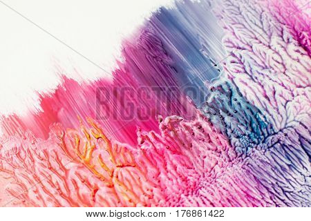 Bright colorful nail polish texture. Purple, pink and red stains of varnish with creative marks and traces. Cosmetic, makeup, beauty, design concept