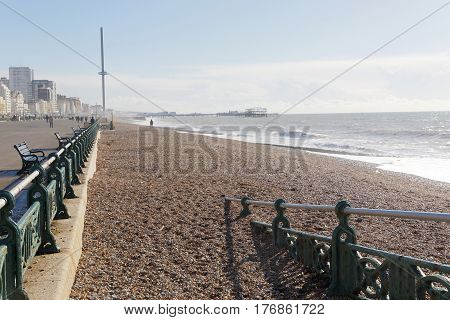 BRIGHTON GREAT BRITAIN - FEB 28 2017: The boardwalk in Brighton and Hove the pier in the background. February 28 2017 in Brighton Great Britain
