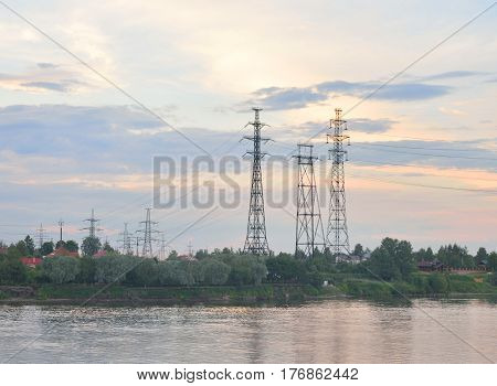 Power line and Neva River at evening on the outskirts of St. Petersburg Russia.